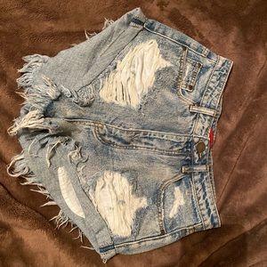 Torn denim shorts